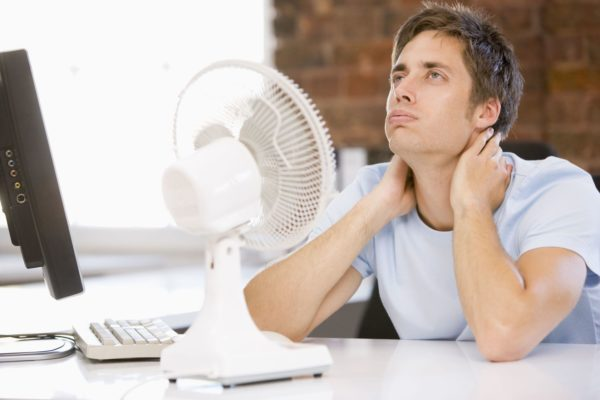 man trying to cool off image