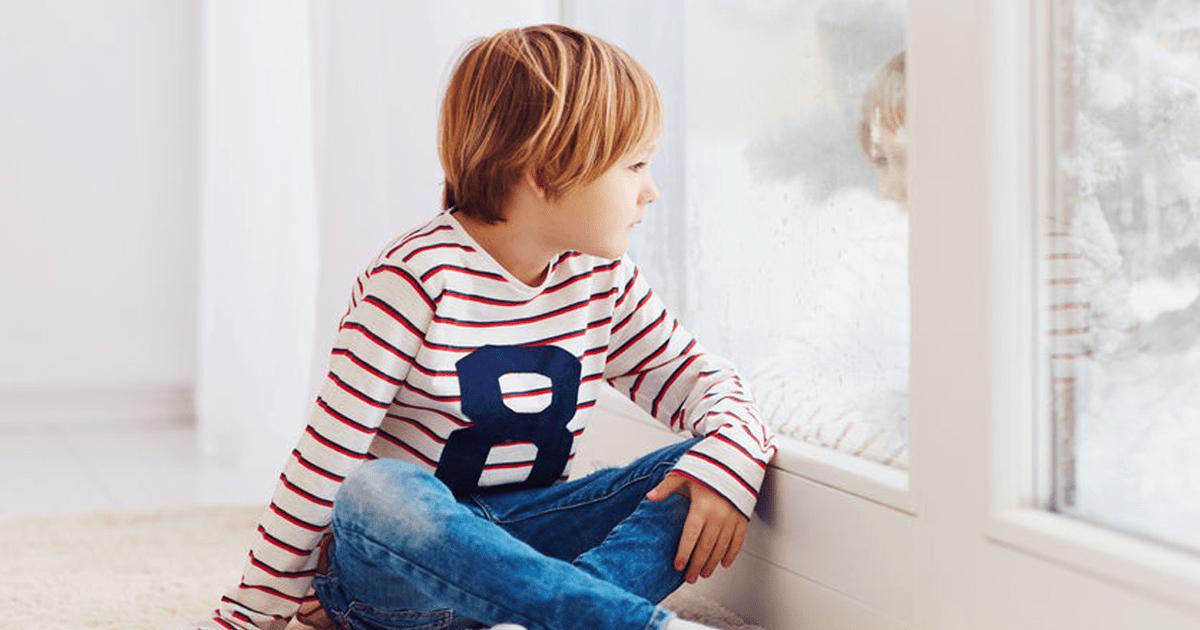 WINTER BLUES BOY AT WINDOW IMAGE