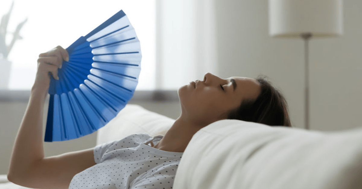 trouble keeping rooms cool image woman with fan